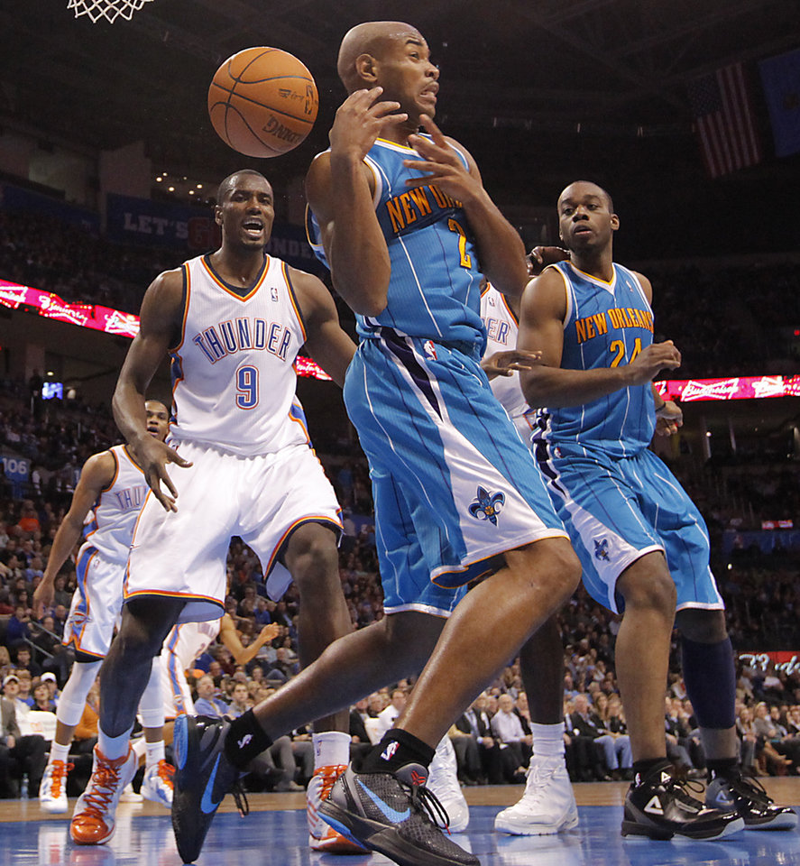 Photo - New Orleans Hornets point guard Jarrett Jack (2) looses the ball in front of Oklahoma City Thunder power forward Serge Ibaka (9) during the NBA basketball game between the Oklahoma City Thunder and the New Orleans Hornets at the Chesapeake Energy Arena on Wednesday, Jan. 25, 2012, in Oklahoma City, Okla. Photo by Chris Landsberger, The Oklahoman