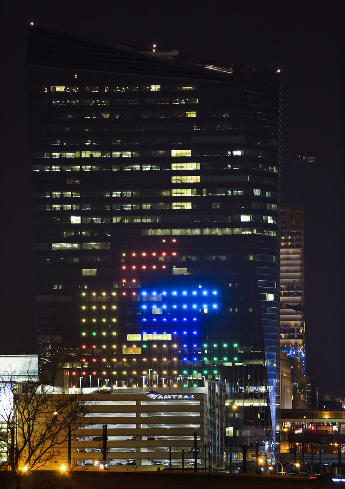 Photo - The classic video game Tetris is played on the 29-story Cira Centre in Philadelphia, Saturday, April 5, 2014, using hundreds of LED lights embedded in its glass facade. The spectacle kicks off a citywide series of events called Philly Tech Week and also celebrates the upcoming 30th anniversary of Tetris. (AP Photo/ Joseph Kaczmarek)