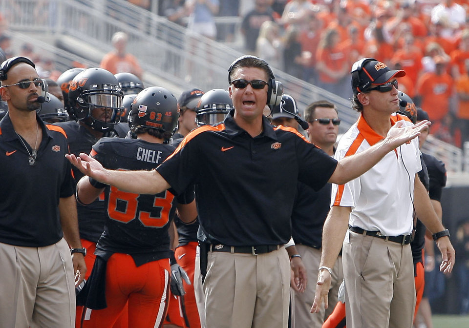 Photo - Oklahoma State head coach argues a call during the first half of the college football game between the Oklahoma State University Cowboys (OSU) and the University of Kansas Jayhawks (KU) at Boone Pickens Stadium in Stillwater, Okla., Saturday, Oct. 8, 2011. Photo by Sarah Phipps, The Oklahoman