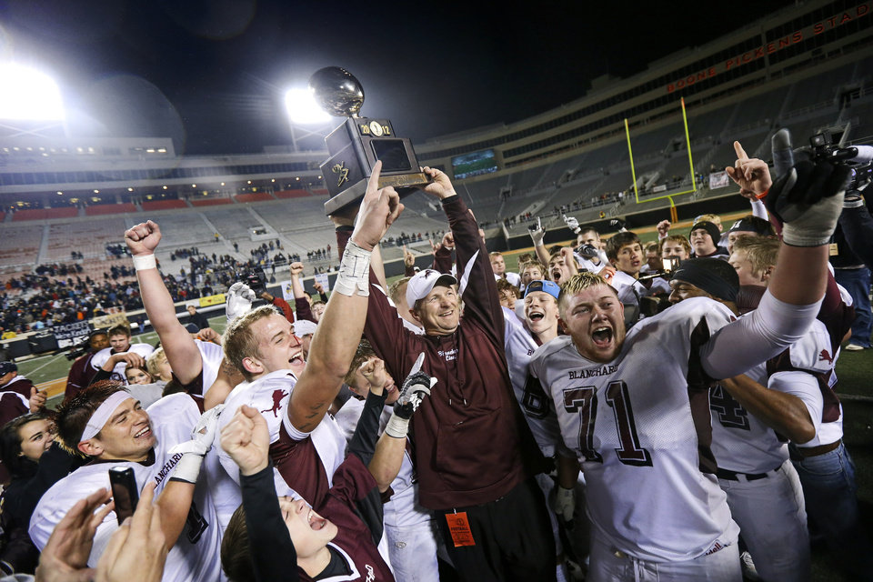 Photo - Blanchard's Zach Hill, left, coach Jeff Craig, and Taylor Oliver celebrate after winning the Class 3A football championship between Blanchard and Kingfisher at Boone Pickens Stadium in Stillwater, Okla., Friday, Dec. 7, 2012. Blanchard won 28-21. Photo by Bryan Terry, The Oklahoman