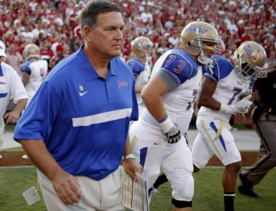 Photo - Tulsa coach Bill Blankenship takes the field with his team before the college football game between the University of Oklahoma Sooners ( OU) and the Tulsa University Hurricanes (TU) at the Gaylord Family-Memorial Stadium on Saturday, Sept. 3, 2011, in Norman, Okla. Photo by Bryan Terry, The Oklahoman ORG XMIT: KOD