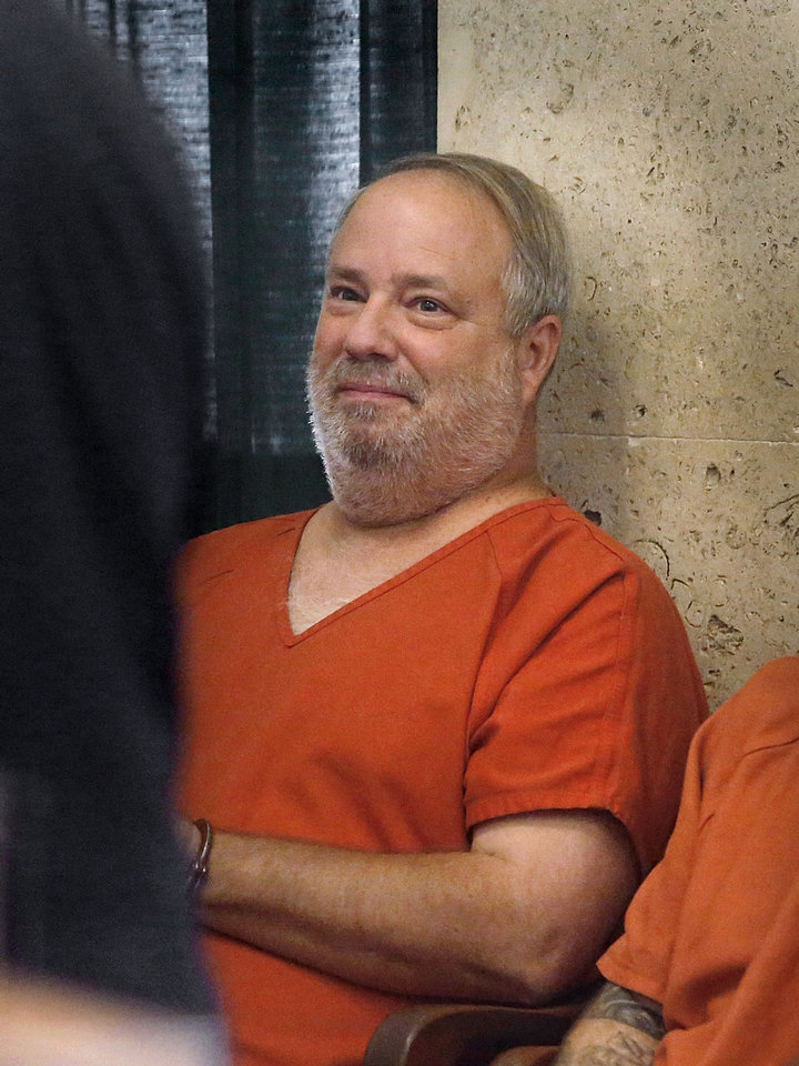 Photo - David Bloebaum, accused of killing a man in a road rage incident in the parking lot of a Target store in northwest Oklahoma City, sits against a wall Wednesday during his appearance before District Judge Kenneth Watson in the Oklahoma County Courthouse. Photo by Jim Beckel, The Oklahoman  Jim Beckel