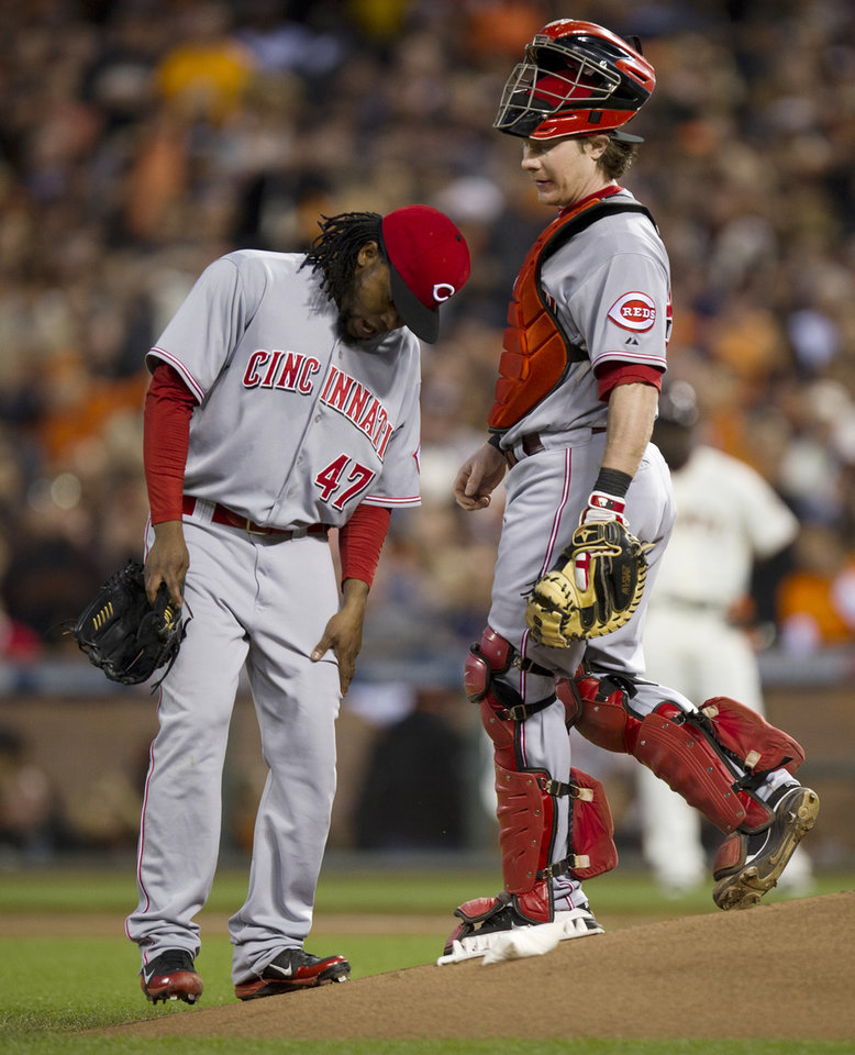 Photo -   Cincinnati Reds starting pitcher Johnny Cueto reacts after he was injured as he pitched to a San Francisco Giants batter during the first inning in Game 1 of the National League baseball division series Saturday, Oct. 6, 2012, in San Francisco. (AP Photo/The Sacramento Bee, Paul Kitagaki Jr.) MAGS OUT; TV OUT (KCRA3, KXTV10, KOVR13, KUVS19, KMAZ31, KTXL40) MANDATORY CREDIT