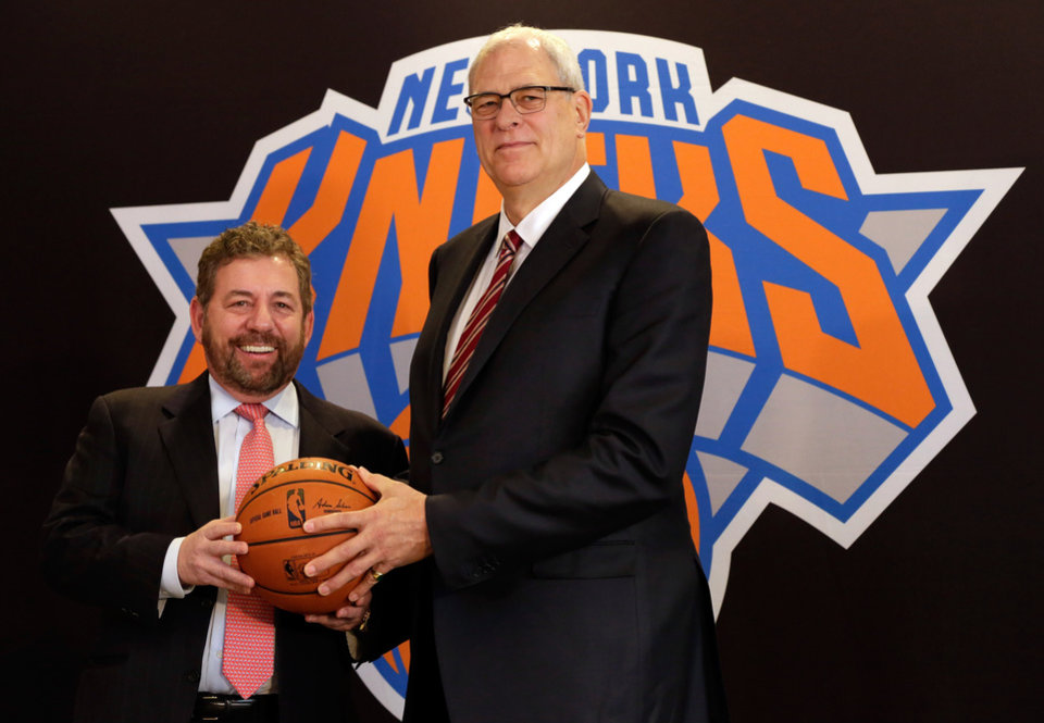 Photo - New York Knicks owner James Dolan, left, and new team president Phil Jackson poses for photos during a news conference where he was introduced, at New York's Madison Square Garden, Tuesday, March 18, 2014. (AP Photo/Richard Drew)