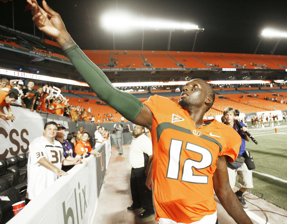 Miami quarterback Jacory Harris throws his sweatbands into the stands after Miami defeated Georgia Tech last Thursday. If OU can win in Miami on Oct. 3, the Sooners could be back in the national title discussion. AP PHOTO