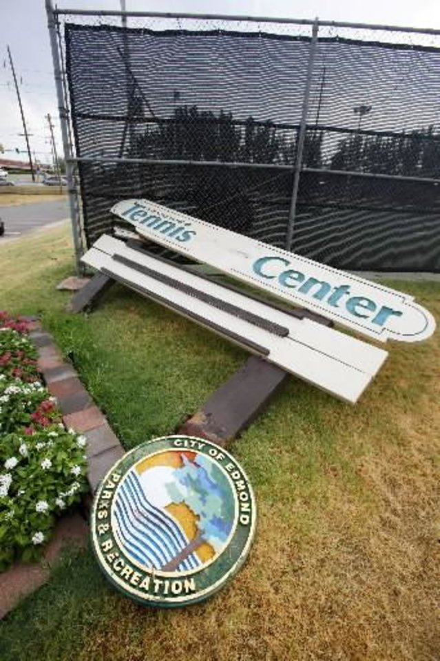 Photo - Sign for Kickingbird Tennis Center destroyed in Edmond after a thunderstorm moved through Wednesday, Aug. 10, 2011. Photo by Paul B. Southerland