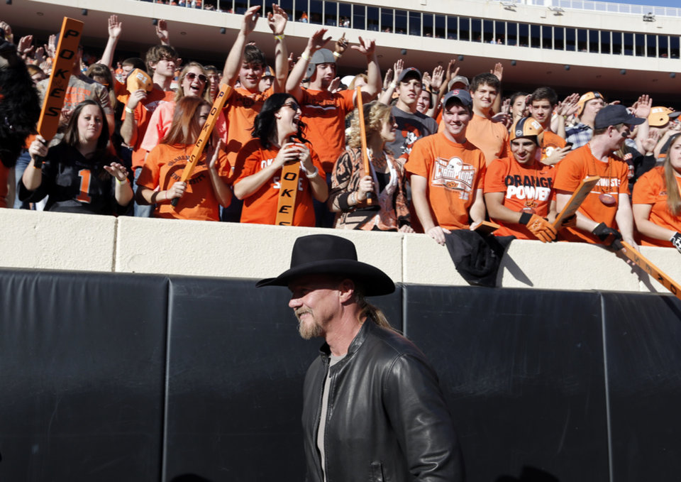 Trace Adkins walks on the field before a college football game between the Oklahoma State University Cowboys (OSU) and the University of Kansas Jayhawks (KU) at Boone Pickens Stadium in Stillwater, Okla., Saturday, Nov. 9, 2013. Photo by Sarah Phipps, The Oklahoman