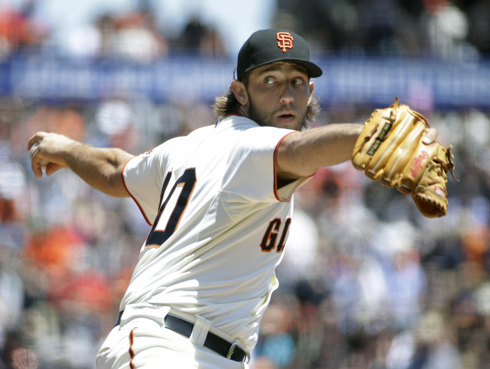 Photo - San Francisco Giants starting pitcher Madison Bumgarner throws in the first inning of their baseball game against the St. Louis Cardinals Thursday, July 3, 2014, in San Francisco. (AP Photo/Eric Risberg)