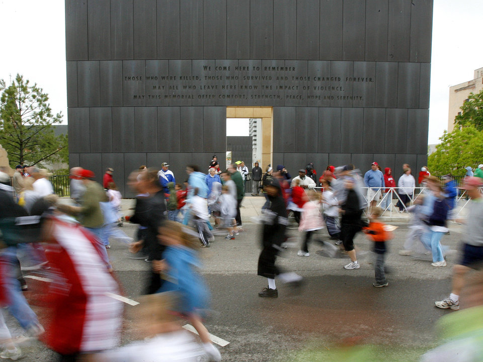 Photo - Participants in the kids marathon race past the Oklahoma CIty Memorial during the Oklahoma City Memorial Marathon, Sunday, April 27, 2008.  BY BRYAN TERRY, THE OKLAHOMAN