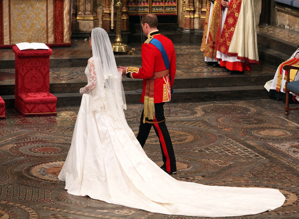 Photo - Kate, the Duchess of Cambridge, and Britain's Prince William walk hand in hand after their wedding service at Westminster Abbey, London, Friday April 29, 2011. (AP Photo/Dominic Lipinski, Pool)  ORG XMIT: RWDJ118