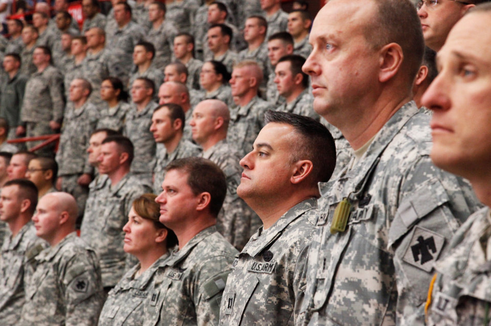 Photo - Troops stand at attention during the 45th Infantry Brigade Combat Team deployment ceremony inside the Cox Convention Center,  Wednesday, Feb. 16, 2011.  Photo by Jim Beckel, The Oklahoman