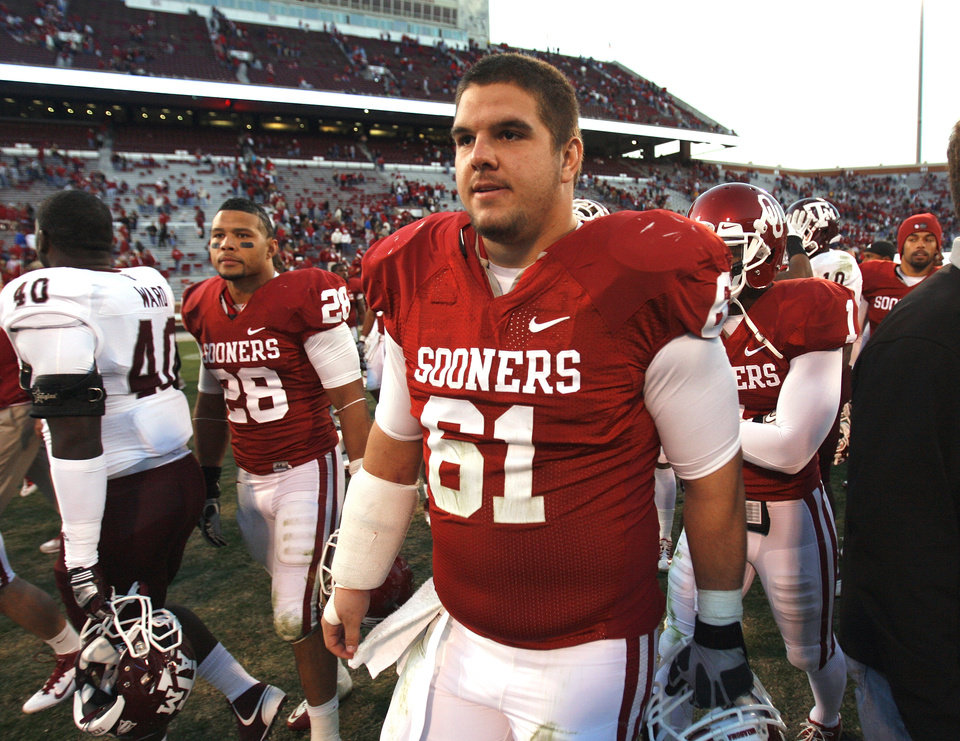 Oklahoma\'s Ben Habern (61) leaves the field following the college football game where the Texas A&M Aggies were defeated by the University of Oklahoma Sooners (OU) 41-25 at Gaylord Family-Oklahoma Memorial Stadium on Saturday, Nov. 5, 2011, in Norman, Okla. Photo by Steve Sisney, The Oklahoman ORG XMIT: KOD