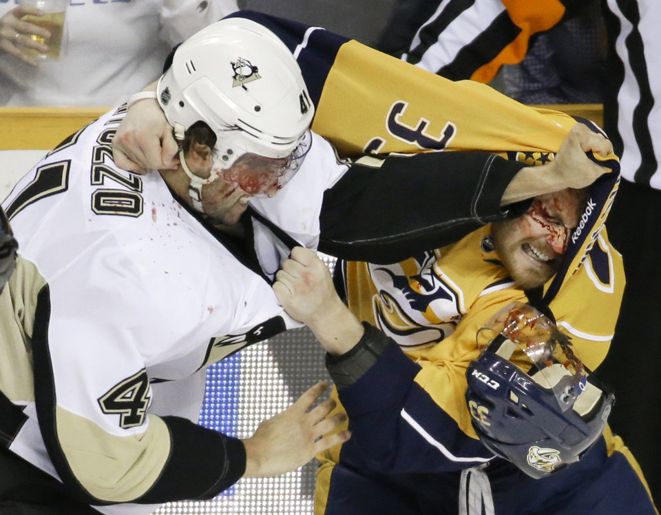 Photo - Pittsburgh Penguins defenseman Robert Bortuzzo (41) fights with Nashville Predators forward Colin Wilson (33) in the first period of an NHL hockey game Tuesday, March 4, 2014, in Nashville, Tenn. (AP Photo/Mark Humphrey)