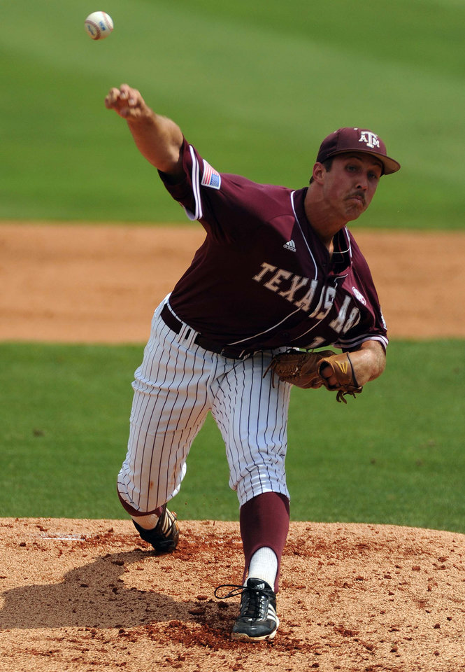 Photo - Texas A&M's Daniel Mengden delivers a pitch during the first inning of an NCAA college baseball regional game against Texas, Friday, May 30, 2014, in Houston. (AP Photo/Houston Chronicle, Eric Christian Smith)