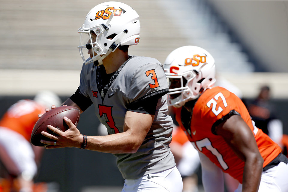 Photo - Oklahoma State's Spencer Sanders (3) looks to throw during drills during the Oklahoma State Cowboys spring practice at Boone Pickens Stadium in Stillwater, Okla., Saturday, April 20, 2019.  Photo by Sarah Phipps, The Oklahoman
