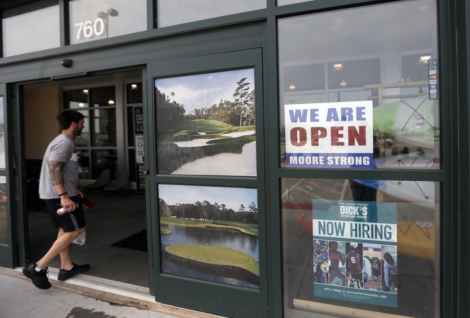 "Many Moore businesses, like this Dick's Sporting Goods, are displaying bright red, white and blue ""WE ARE OPEN"" signs to lure customers who might think the destruction of Monday's tornado has shut down the city's economy. <strong>Sarah Phipps - the oklahoman</strong>"