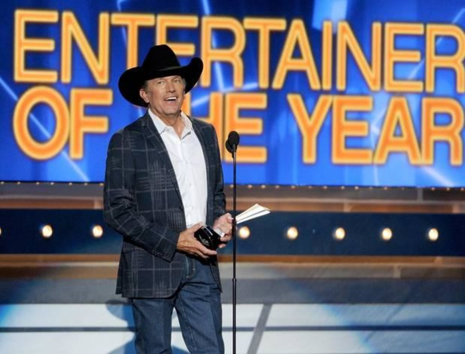 Photo -  George Strait accepts the award for entertainer of the year at the 49th annual Academy of Country Music Awards at the MGM Grand Garden Arena on Sunday, April 6, 2014, in Las Vegas. (AP)