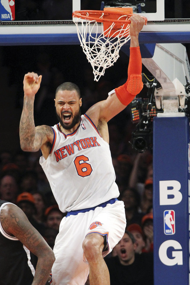 Photo - New York Knicks' Tyson Chandler reacts after dunking during the second half of NBA basketball game against the Brooklyn Nets, Wednesday, Dec. 19, 2012, at Madison Square Garden in New York. The Knicks won 100-86. (AP Photo/Mary Altaffer)