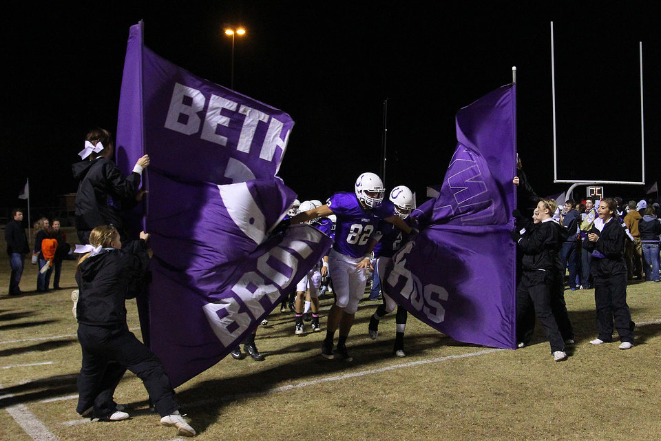 Photo - Bethany Broncos players crash through the banner before the Class 3A quarterfinals between Bethany and Cascia Hall in Bethany, Friday, November 25, 2011. PHOTO BY HUGH SCOTT, FOR THE OKLAHOMAN