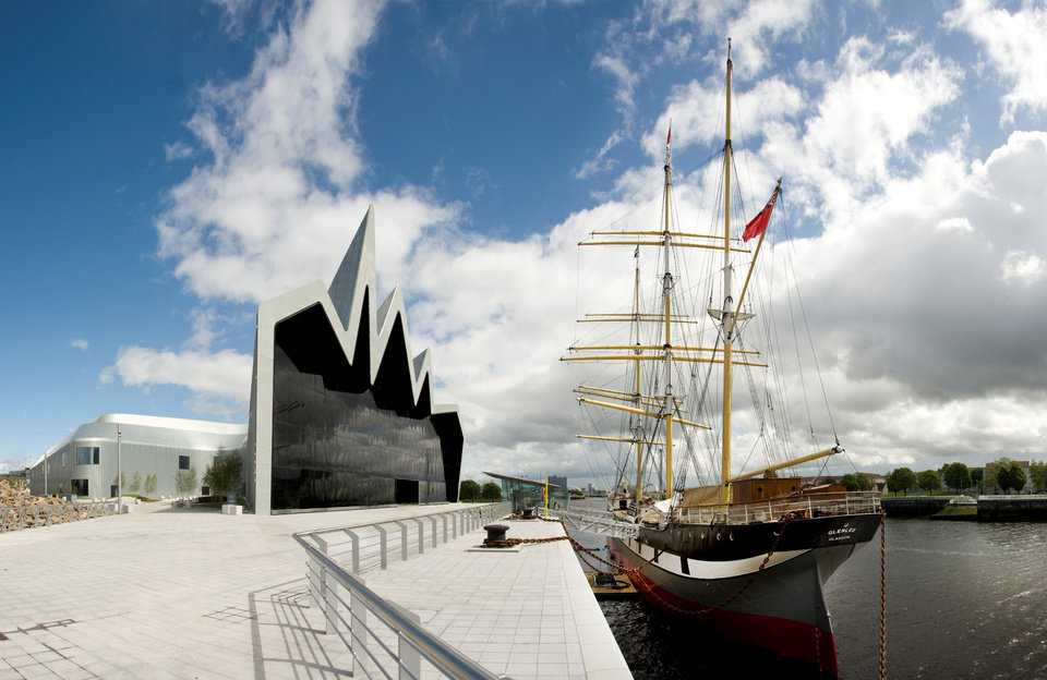 Photo - This undated photo provided by Glasgow City Marketing Bureau shows the Riverside Museum on the banks of the Clyde River in Glasgow, Scotland. Its exhibits include a sailing ship permanently moored outside the museum. The museum, which is free to visit, was designed by renowned architect Zaha Hadid. (AP Photo/Glasgow City Marketing Bureau)