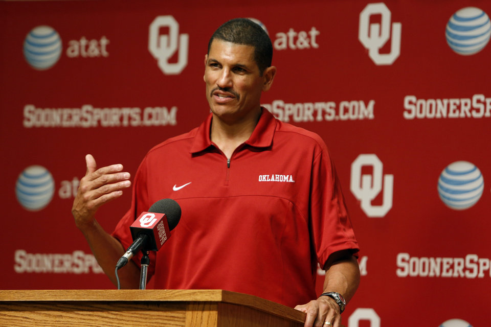 Photo - Co-offensive coordinator Jay Norvell speaks during media access day for the University of Oklahoma Sooner (OU) football team in the Adrian Peterson meeting room in Gaylord Family-Oklahoma Memorial Stadium in Norman, Okla., on Saturday, Aug. 3, 2013. Photo by Steve Sisney, The Oklahoman
