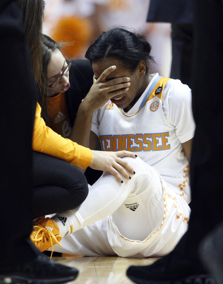 Photo - Tennessee guard Ariel Massengale (5) covers her face after being injured in the first half of an NCAA college basketball game against Florida, Thursday, Jan. 23, 2014, in Knoxville, Tenn. Massengale didn't return to the game after getting hit in the face while making a steal late in the first half. No. 11 Tennessee defeated Florida 89-69. (AP Photo/Wade Payne)