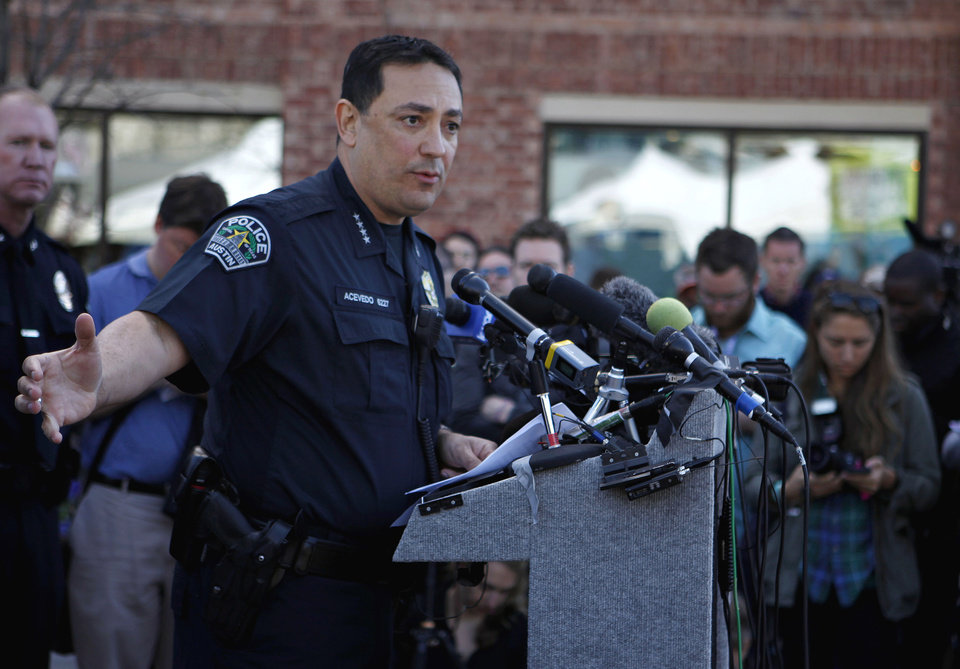 Photo - Austin Police Chief address the media during a news conference on Thursday, March 13, 2014 in Austin, Texas.  A suspected drunken driver barreled through police barricades and drove down a crowded street at the South by Southwest festival early Thursday morning, killing two people and injuring 23 in an act authorities say was intentional.  The driver struck multiple pedestrians at about 12:30 a.m. on a block filled with concertgoers, continued down the street and hit and killed a man from the Netherlands on a bicycle and a woman from Austin on a moped, Acevedo said.  (AP Photo/The Daily Texan, Shweta Gulati)
