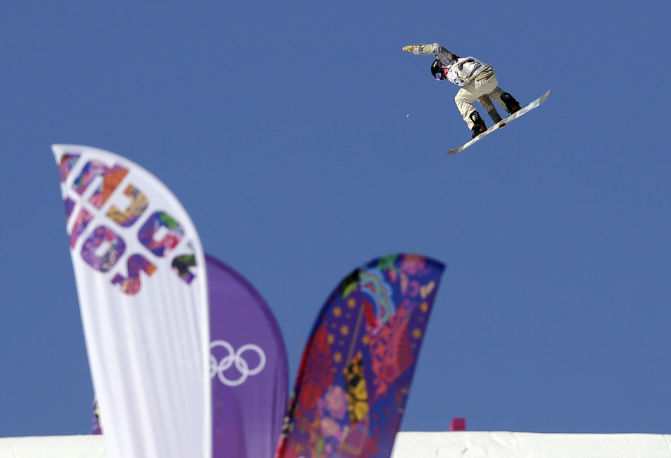 Photo - United States' Ryan Stassel takes a jump during the men's snowboard slopestyle qualifying at the Rosa Khutor Extreme Park ahead of the 2014 Winter Olympics, Thursday, Feb. 6, 2014, in Krasnaya Polyana, Russia.  (AP Photo/Andy Wong)