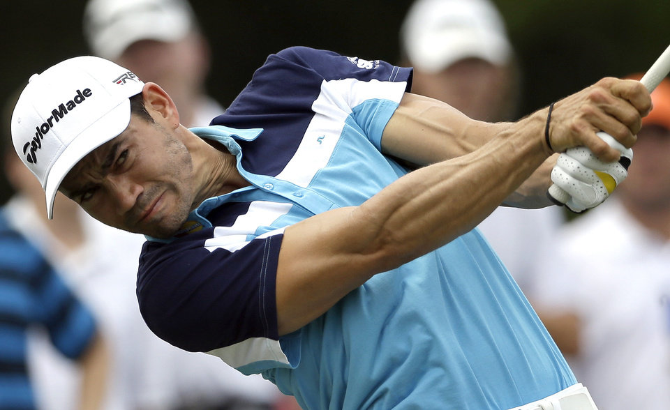 Photo - Camilo Villegas, of Colombia, hits a tee shot on the 16th hole during the final round of the Wyndham Championship golf tournament in Greensboro, N.C., Sunday, Aug. 17, 2014. Villegas won the tournament with a 17 under-par 263. (AP Photo/Gerry Broome)