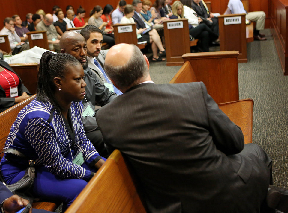 Assistant state attorney Bernie de la Rionda, right front, speaks with Trayvon Martin\'s parents Sybrina Fulton, left and Tracy Martin, center, at the end of the lunch recess during George Zimmerman\'s trial in Seminole circuit court in Sanford, Fla. Wednesday, June 26, 2013. Zimmerman has been charged with second-degree murder for the 2012 shooting death of Trayvon Martin.(AP Photo/Orlando Sentinel, Jacob Langston, Pool)