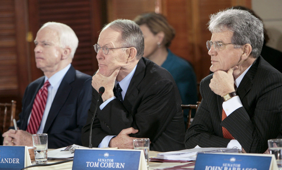 Photo - Sen. Tom Coburn, R-Muskogee, listens  Thursday during the health care summit at the Blair House in  Washington. AP PHOTO
