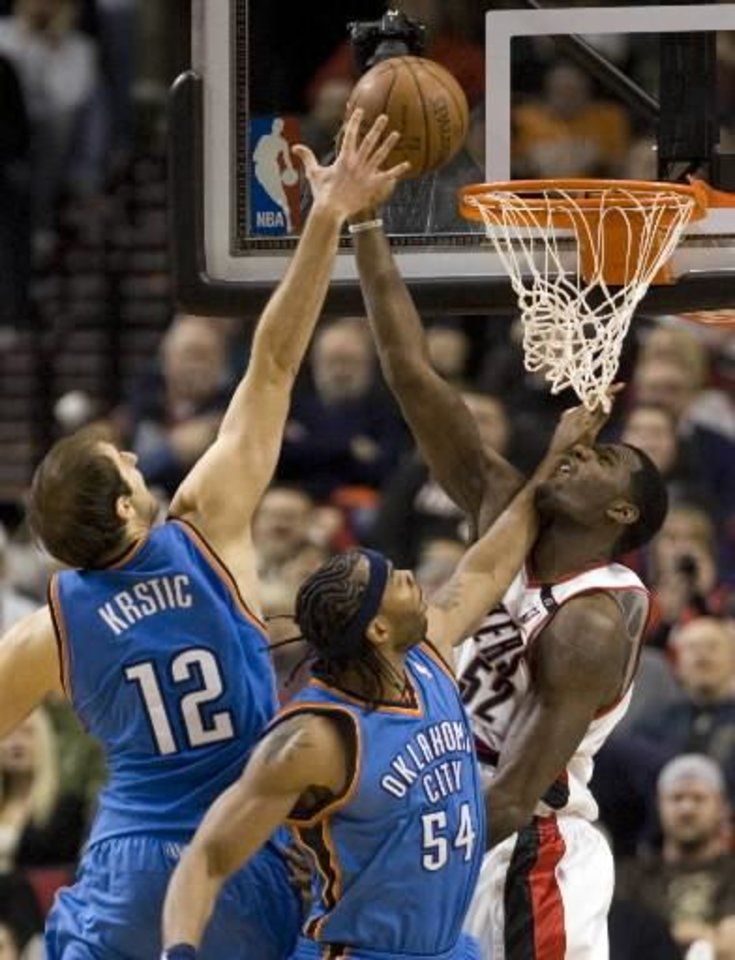 Photo - Portland  Trail  Blazers center Greg Oden, right, shoots a reverse layup against Oklahoma City  Thunder's Nenad Krstic, left, from Serbia, and Chris Wilcox during the second half of an NBA basketball game in Portland, Ore., Wednesday, Feb. 11, 2009. Portland defeated Oklahoma City 106-92. AP Photo