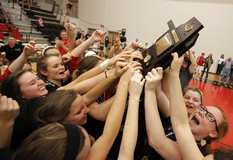 Bishop Kelley holds up their trophy after winning the OSSAA 6A State Volleyball Championship between Bishop Kelley and Edmond Memorial at Westmoore High School in Moore, Okla., Saturday, Oct. 13, 2012.  Photo by Garett Fisbeck, The Oklahoman