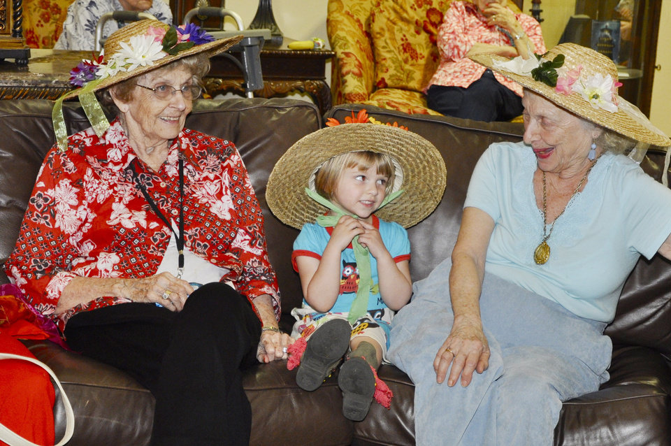 Ethelda Higgs, 90, Eliana Anderson, 4, and Betty Lawrence, 86, chat while waiting for the Easter bonnet parade to begin at Touchmark at Coffee Creek. Photo by M. Tim Blake, For The Oklahoman  <strong>M. Tim Blake</strong>