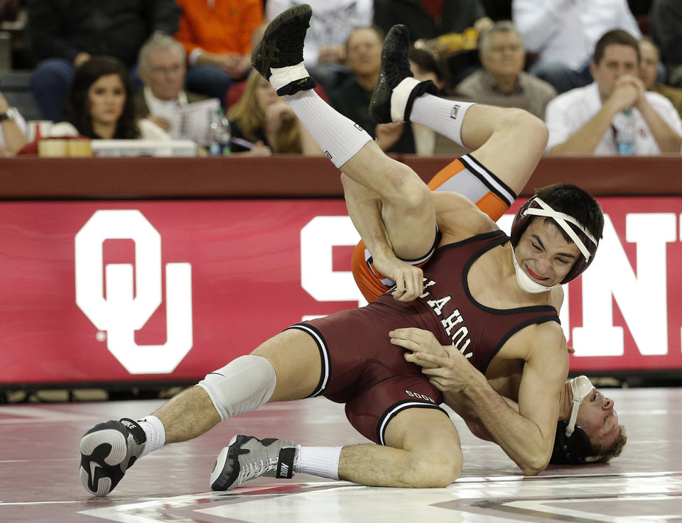 OU's Kyle Garcia wrestles OSU's Tyler Dorrell during the wrestling match between Oklahoma University and Oklahoma State University at McCasland Field House in Norman, Okla.,Sunday, Dec. 9, 2012.  Photo by Garett Fisbeck, For The Oklahoman