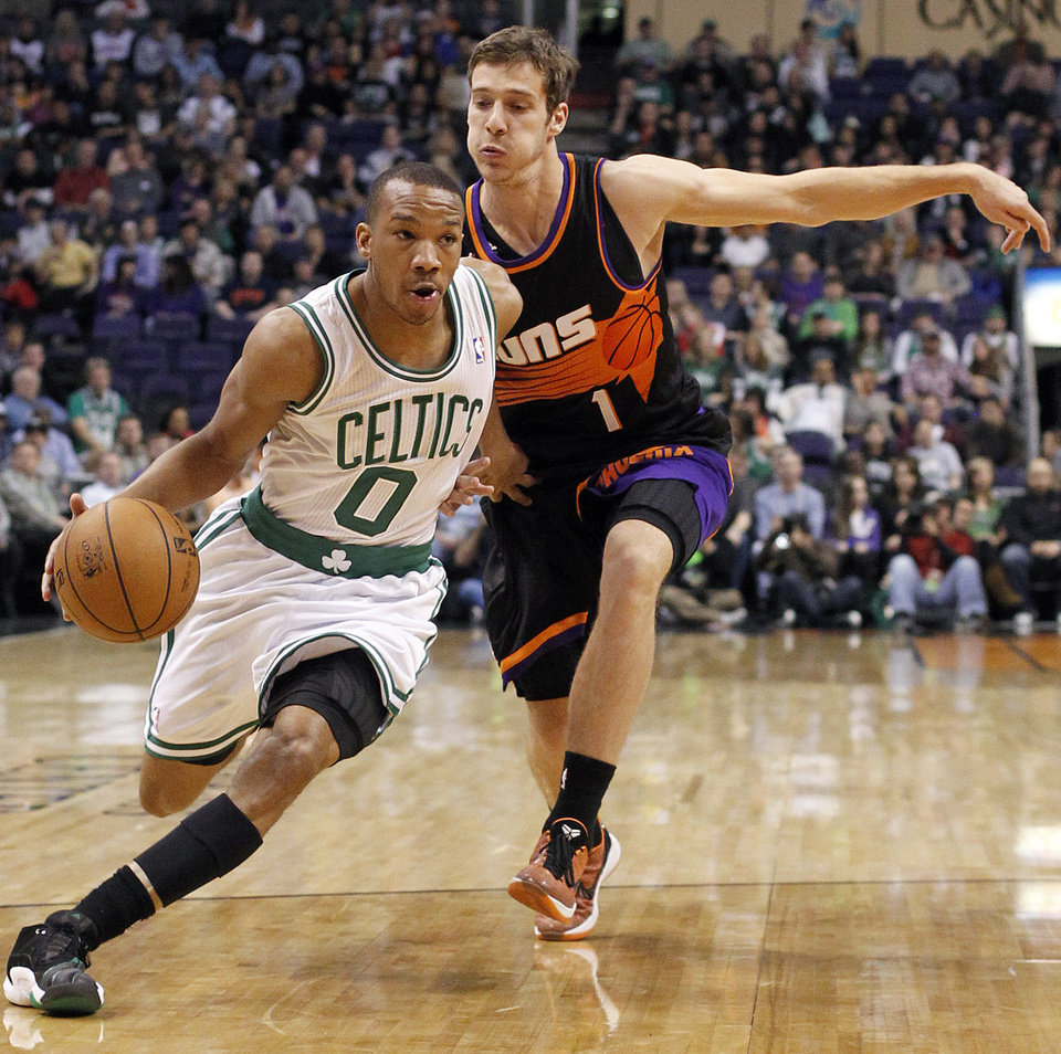 Boston Celtics guard Avery Bradley, left, drives past Phoenix Suns guard Goran Dragic, right, of Slovenia, in the first half of an NBA basketball game, Friday, Feb. 22, 2013, in Phoenix. (AP Photo/Paul Connors)