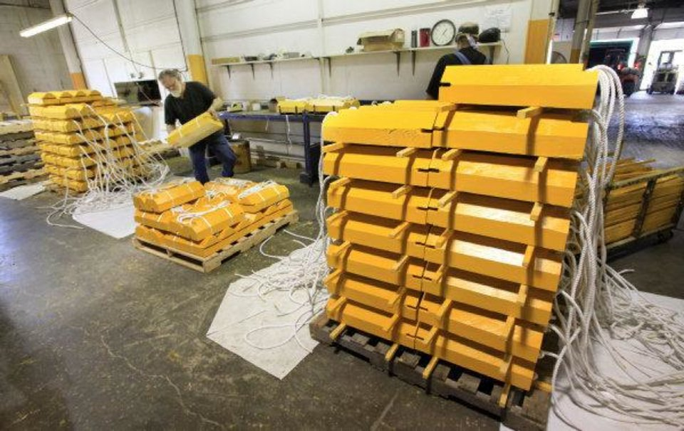 Photo - Aircraft wheel chock blocks are manufactured for a military contract at NewView (CQ NewView one word) in Oklahoma City Monday.  PAUL B. SOUTHERLAND - PAUL B. SOUTHERLAND