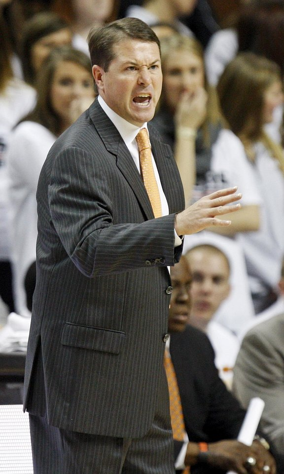 Photo - OSU head coach Travis Ford during a men's college basketball between Oklahoma State University and Missouri State at Gallagher-Iba Arena in Stillwater, Okla., Saturday, Dec. 8, 2012. Photo by Nate Billings, The Oklahoman
