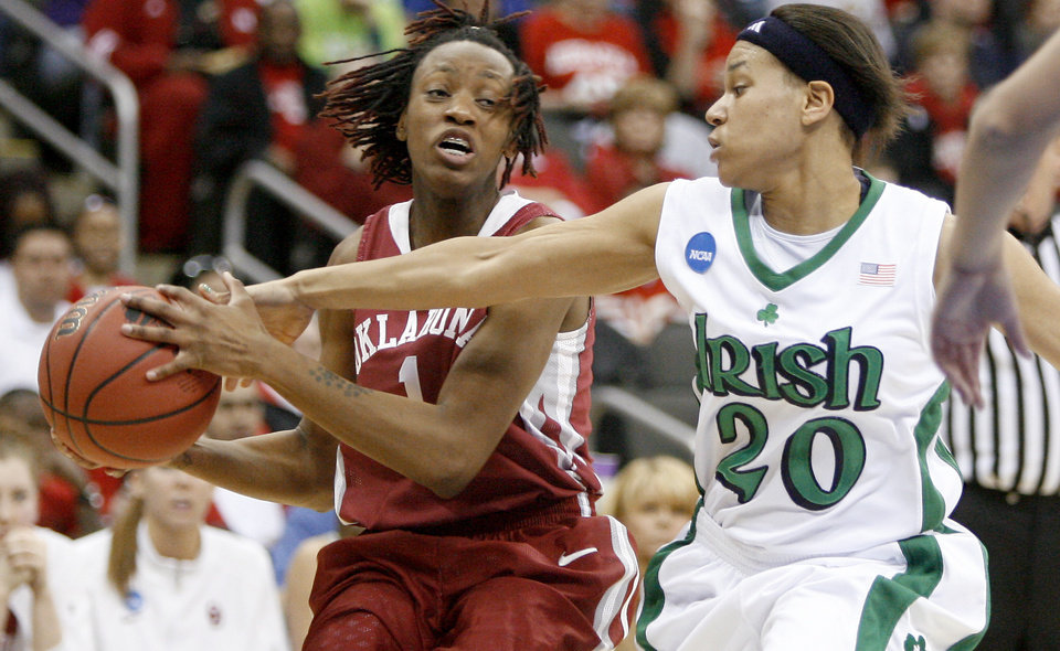 Photo - OU's Nyeshia Stevenson tries to pass the ball around Notre Dame's Ashley Barlow during the Sweet 16 round of the NCAA women's  basketball tournament in Kansas City, Mo., on Sunday, March 28, 2010. 