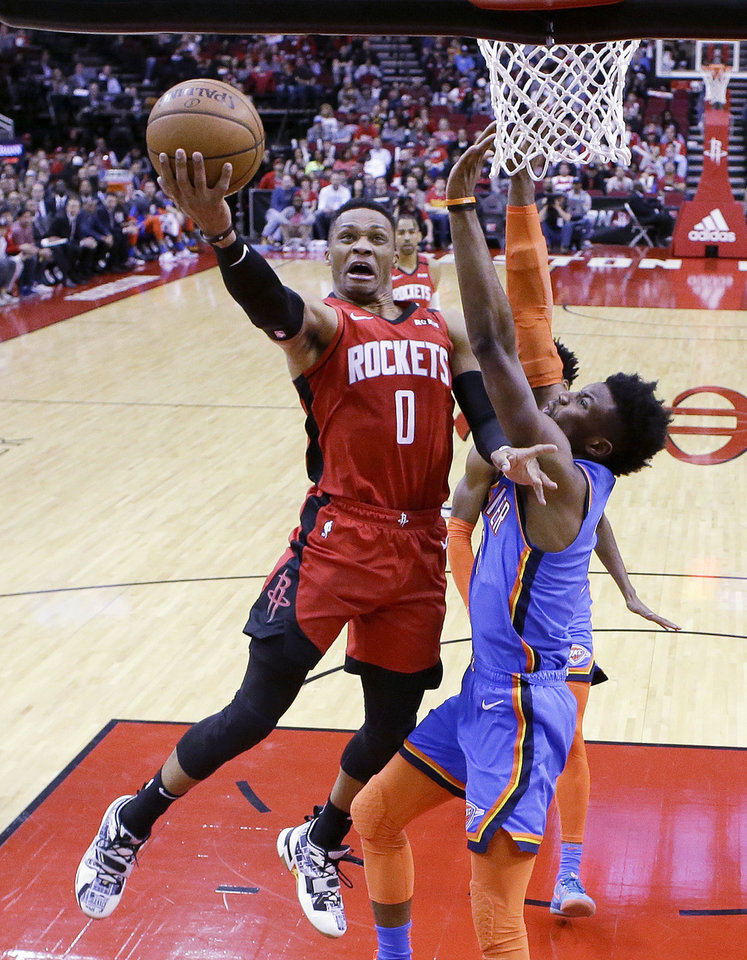 Photo - Houston Rockets guard Russell Westbrook (0) drives to the basket as Oklahoma City Thunder guard Hamidou Diallo defends during the first half of an NBA basketball game, Monday, Jan. 20, 2020, in Houston. (AP Photo/Eric Christian Smith)