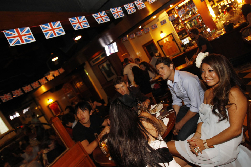 Photo - Local Taiwanese and expats watch the Royal Wedding of Prince William and Kate Middleton at a local pub in Taipei, Taiwan, April 29, 2011. (AP Photo/Wally Santana) ORG XMIT: TPE102