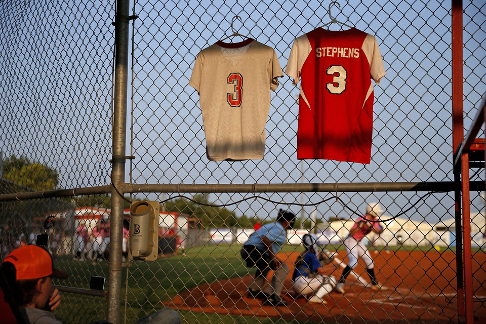 Photo - Jacie Stephens Cochran jerseys hang in honor of her during softball game in Washington, Okla., Thursday, Sept. 17, 2020. Jacie died July 2 shortly after giving birth to her son Jaxon. [Bryan Terry/The Oklahoman]