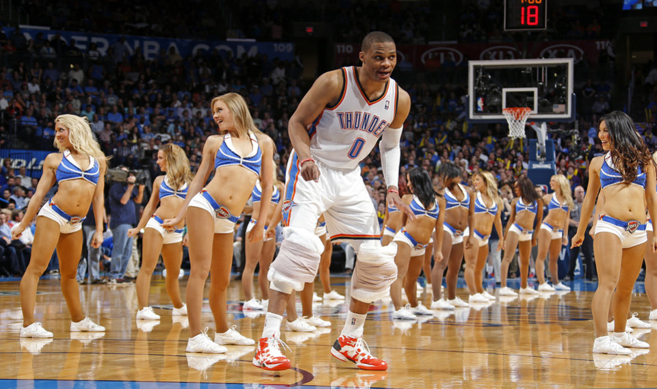 Photo - Oklahoma City's Russell Westbrook (0) stands on the court as he talks to teammates during a time out in an NBA basketball game between the Oklahoma City Thunder and the San Antonio Spurs at Chesapeake Energy Arena in Oklahoma City, Thursday, April 3, 2014. Oklahoma City won 106-94. PHOTO BY BRYAN TERRY, The Oklahoman
