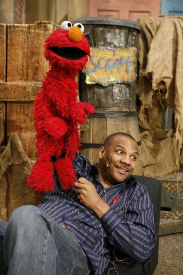 "Kevin Clash, seen with Elmo, is the subject of ""Being Elmo: A Puppeteer's Journey."" Photo provided <strong>RICHARD TERMINE</strong>"
