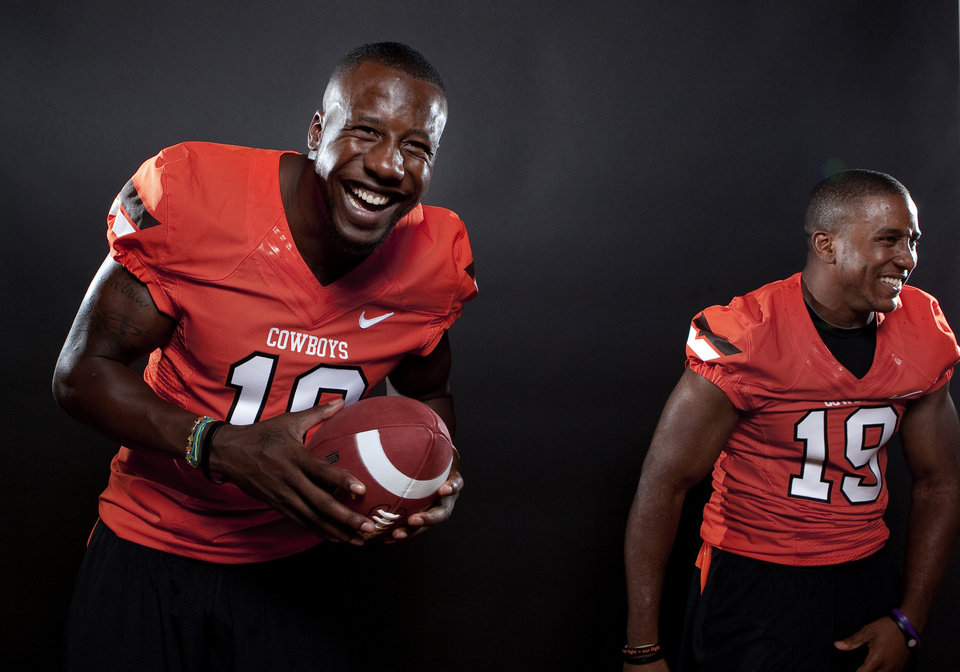 Photo - Oklahoma State's Markelle Martin (10) and Brodrick Brown (19) pose for a photo during Oklahoma State's Football media day at  in Stillwater, Okla., Saturday, Aug. 6, 2011. Photo by Sarah Phipps, The Oklahoman