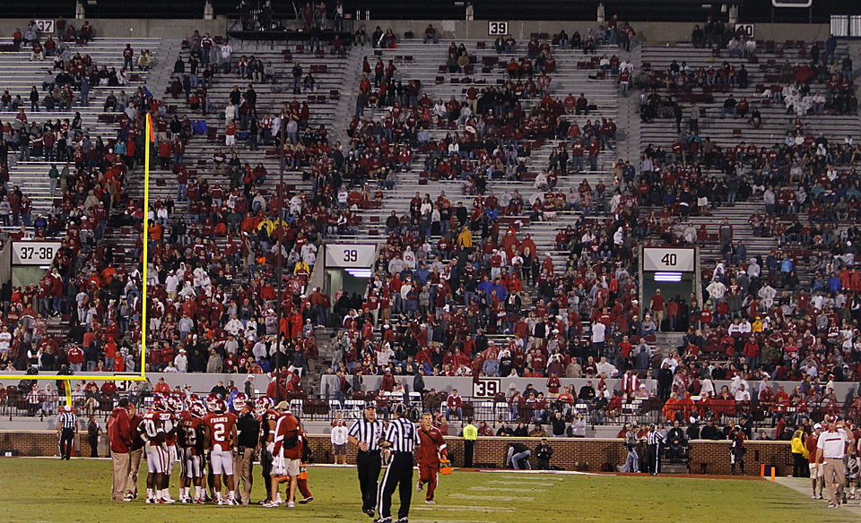 Sooner fans begin to clear out of the stands in Oklahoma's 41-38 loss to Texas Tech during the college football game between the University of Oklahoma Sooners (OU) and Texas Tech University Red Raiders (TTU) at the Gaylord Family-Oklahoma Memorial Stadium on Sunday, Oct. 23, 2011. in Norman, Okla. Photo by Chris Landsberger, The Oklahoman