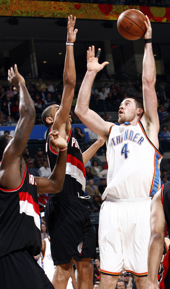 Oklahoma City's Nick Collison (4) take a shot during the NBA basketball game between the Oklahoma City Thunder and the Portland Trail Blazers at the Ford Center in Oklahoma City, Friday, February 6, 2009. BY NATE BILLINGS, THE OKLAHOMAN