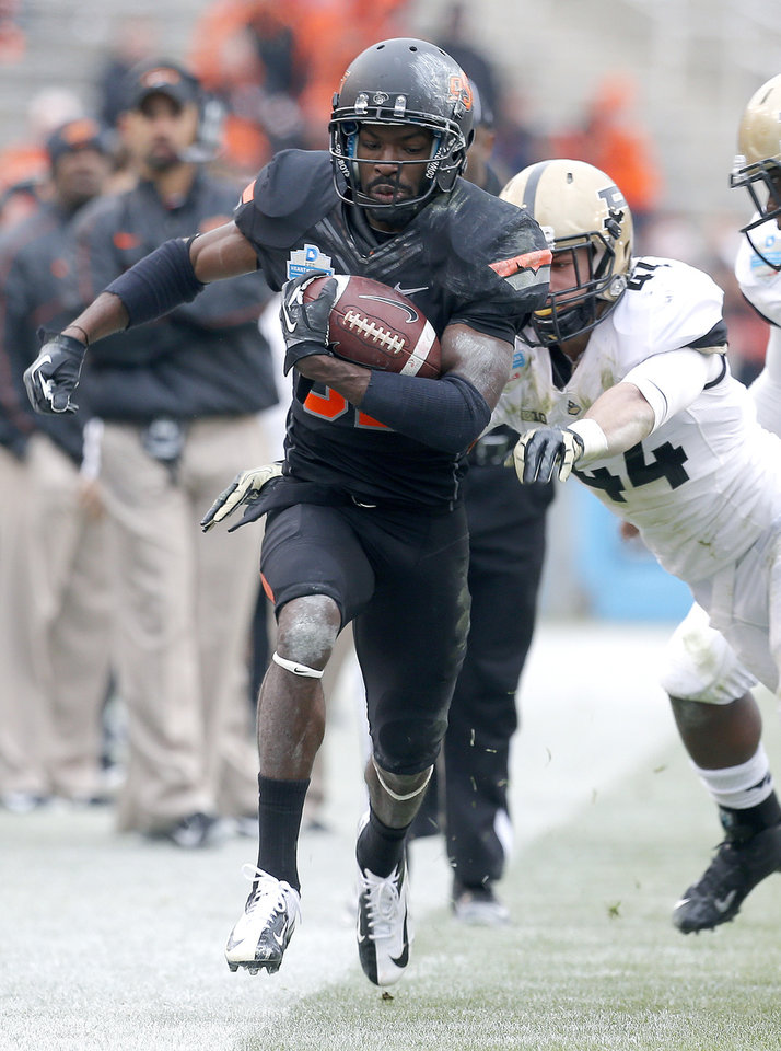 Photo - Oklahoma State's Isaiah Anderson (82) gets past Purdue's Landon Feichter (44) during the Heart of Dallas Bowl football game between the Oklahoma State University (OSU) and Purdue University at the Cotton Bowl in Dallas,  Tuesday,Jan. 1, 2013. Photo by Sarah Phipps, The Oklahoman