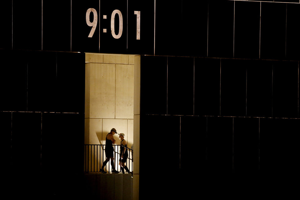 Photo - Runners enter the the Oklahoma City National Memorial before  the Oklahoma City Memorial Marathon in Oklahoma City, Sunday, April 28, 2019. [Bryan Terry/The Oklahoman]