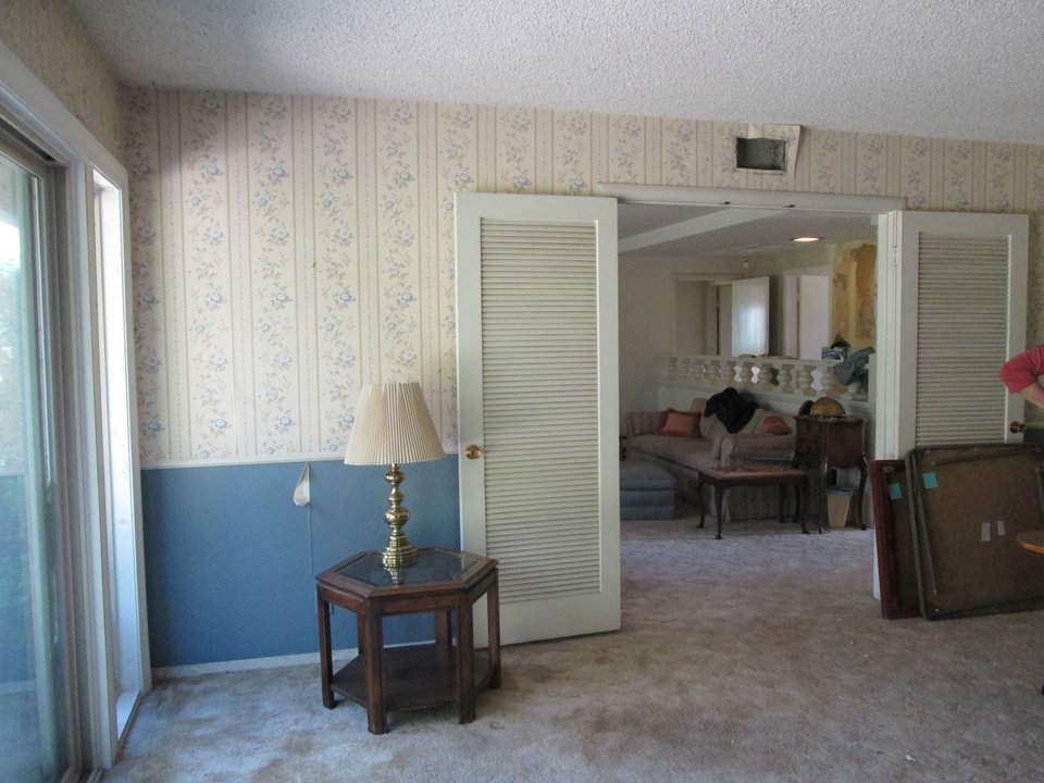 Before and after: To get this 50-year-old, one-owner home ready for a buyer, we put it through a time  machine. The cellulite ceilings, dowdy carpet and floral wallpaper had to go. We updated the interior shell with wood laminate flooring and warm neutral paint paired with crisp white trim and thicker baseboards.  Photos provided